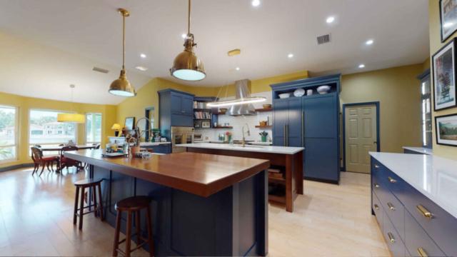 Sleek modern kitchen with eating area